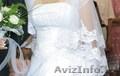 свадебное платье вышити бисероами и со стразами