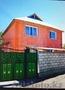 Добротный двухэтажный кирпичный дом в центре города